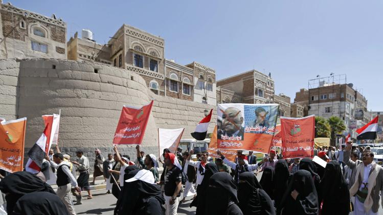 Anti-government protesters march during a demonstration demanding the resignation of Yemen's PM Basindwa in Sanaa