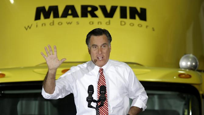 Republican presidential candidate, former Massachusetts Gov. Mitt Romney gestures while speaking at a campaign event at Integrity Windows in Roanoke, Va., Thursday, Nov. 1, 2012.  (AP Photo/David Goldman)