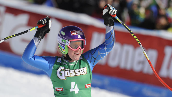 Alice McKennis, from the United States, celebrates as she crosses the finish line to win an alpine ski, women's World Cup downhill in St. Anton, Austria, Saturday, Jan.12, 2013. (AP Photo/Giovanni Auletta)