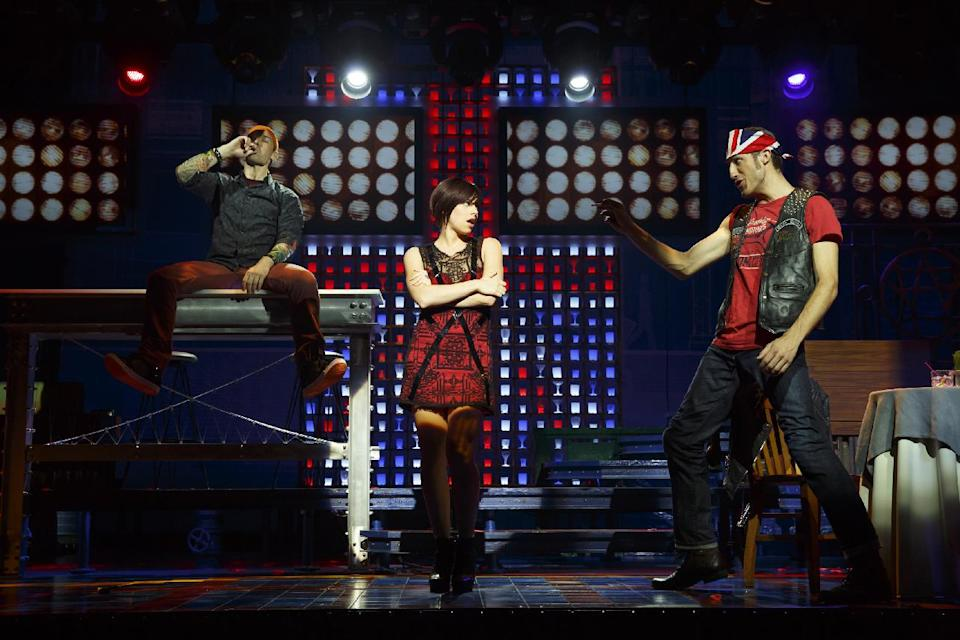 "This theater publicity image released by The Hartman group shows Kristoffer Cusick, left, Krysta Rodriguez, center, and Bryce Ryness during a performance of the musical ""First Date,"" at the Longacre Theatre in New York. (AP Photo/The Hartman Group, Joan Marcus)"