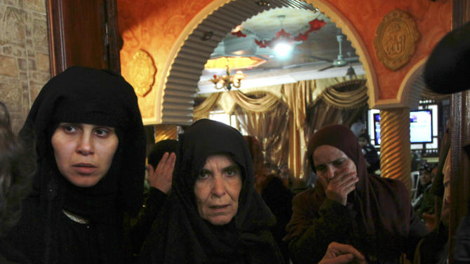 Palestinian women react during the funeral of Yasser Al-Attal, 22, a militant from the Popular Front for the Liberation of Palestine (PFLP), in Khan Younis, southern Gaza Strip Sunday, Oct. 14, 2012. Al-Attal was killed during an Israeli air strike east of Khan Younis early Sunday. According to Israel's army spokesperson Israeli aircraft hit Gaza militants planning a rocket attack. (AP Photo/Adel Hana)
