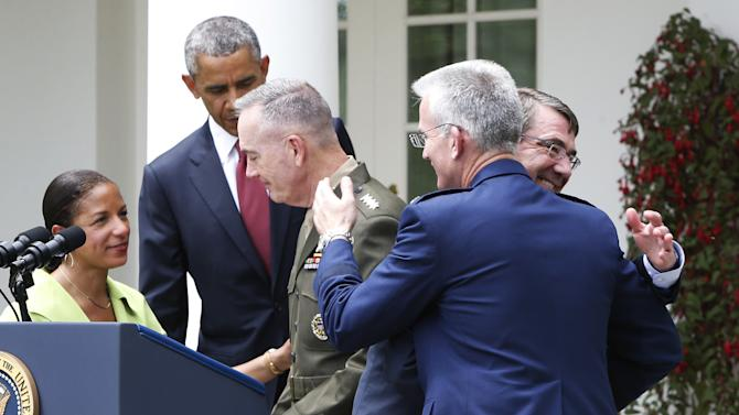 Rice, Obama, Dunford, Selva and Carter embrace one another after Obama named Dunford as nominee to be the next chairman of the Joint Chiefs of Staff, in the Rose Garden at the White House in Washington