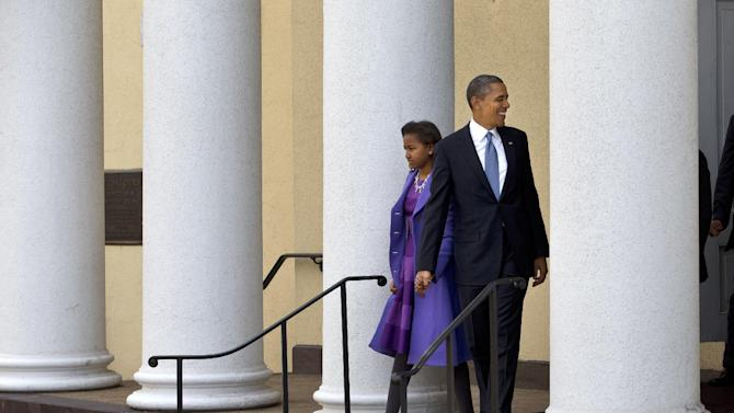 President Barack Obama and daughter Sasha leaves St. John's Church in Washington, Monday, Jan. 21, 2013, after attending a church service during the 57th Presidential Inauguration. (AP Photo/Jacquelyn Martin)