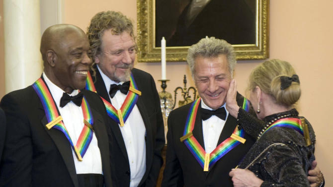2012 Kennedy Center Honoree Natalia Makarova, right, congratulates fellow honoree Dustin Hoffman, second from right, as he stands with honorees Buddy Guy, left, and Robert Plant, after the State Department Dinner for the Kennedy Center Honors gala Saturday, Dec. 1, 2012 at the State Department in Washington. (AP Photo/Kevin Wolf)