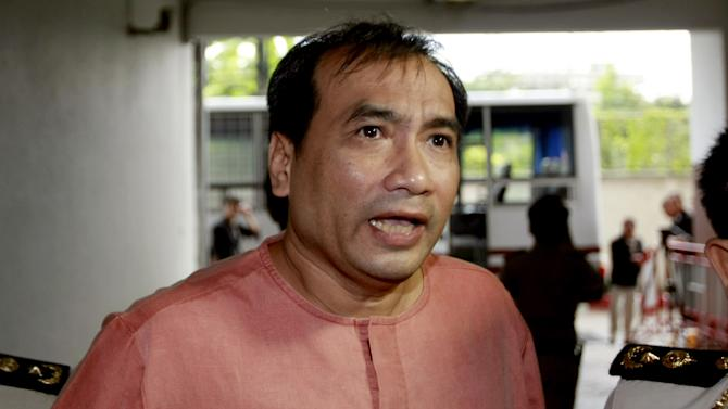 "FILE - In this Oct. 10, 2011 file photo, Joe Gordon, a Thai-born American, speaks to reporters upon his arrival at criminal court in Bangkok, Thailand. Gordon who spent more than a year in prison on charges of insulting Thailand's king said Thursday, Nov. 8, 2012 the country's strict lese majeste law is holding back the country's democratic development, and has vowed never to return until his motherland stops being so ""thin-skinned"" and allows full freedom of expression. (AP Photo/Apichart Weerawong, File)"