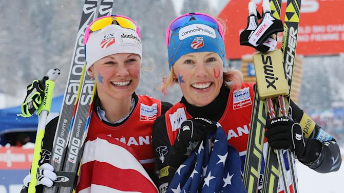 The winner Jessica Diggins, right, and teammate Kikkan Randall of the United States celebrate after finishing the Ladies 6x1.2 km Free Team Sprint at the Nordic Ski World Championships in Val di Fiemme,Italy, Sunday Feb.24,2013.(AP Photo/Armando Trovati)