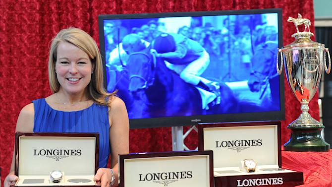 IMAGE DISTRIBUTED FOR LONGINES - Jennifer Judkins, Longines U.S. Brand President, poses with the Kentucky Derby trophy and Longines timepieces at the Taste of Derby, Thursday, May 2, 2013, in Louisville, Ky.  Longines, the Swiss watch manufacturer known for its luxury timepieces, is the Official Watch and Timekeeper of the 139th annual Kentucky Derby. (Diane Bondareff/Invision for Longines/AP Images)