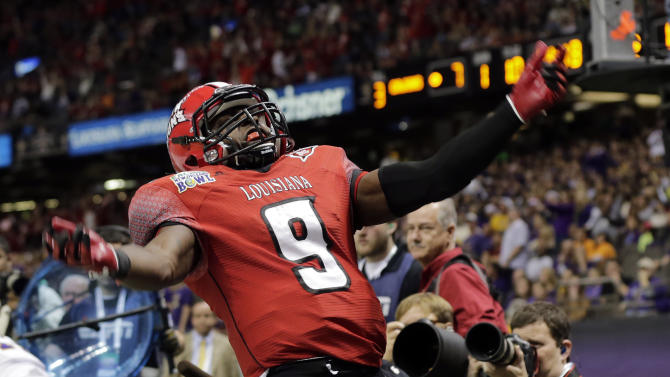 Louisiana-Lafayette wide receiver Harry Peoples (9) reacts after scoring against East Carolina in the first half of the New Orleans Bowl, an NCAA college football game in New Orleans, Saturday, Dec. 22, 2012. (AP Photo/Dave Martin)
