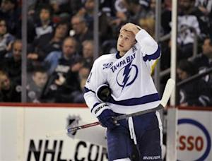 Lightning's Stamkos looks up at the score clock during a break in play against the Jets during the second period of their NHL hockey game in Winnipeg