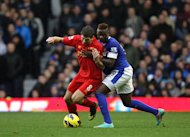 England captain Steven Gerrard, left, believes Liverpool are a better side than Everton