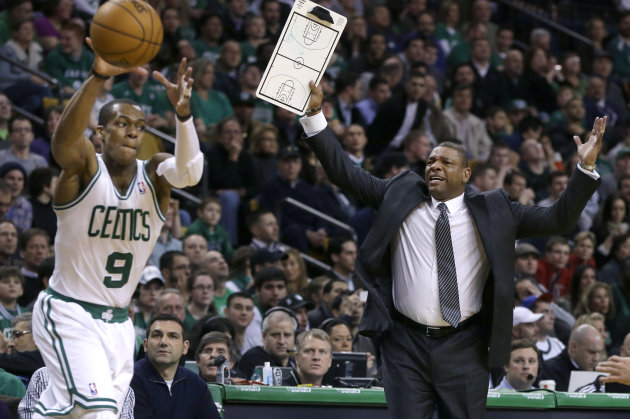 Boston Celtics head coach Doc Rivers, right, gestures for a time out as Boston Celtics point guard Rajon Rondo (9) handles the ball with under a minute left in the second quarter of an NBA basketball
