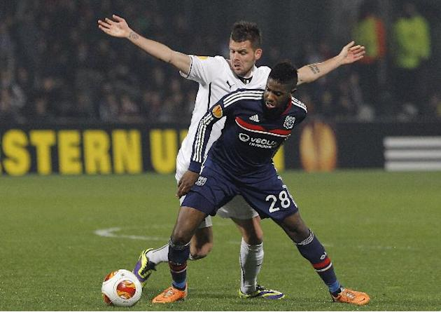 Lyon's Arnold Mvuemba, front, challenges for the ball with Viktoria Plzen's Michal Duris during their Europa League soccer match in Lyon, central France, Thursday, March 13, 2014
