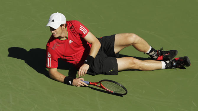Andy Murray of Britain reacts during a quarterfinal match against John Isner at the U.S. Open tennis tournament in New York, Friday, Sept. 9, 2011. (AP Photo/Charlie Riedel)