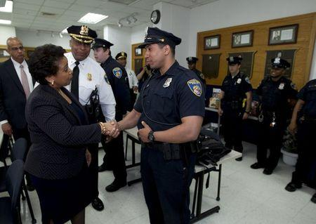 In Baltimore, U.S. attorney general pledges to help police reform