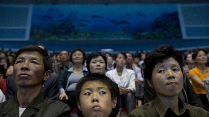 In this Sept. 8, 2012 photo, people watch a dolphin show at a newly-built amusement park in Pyongyang, North Korea. (AP Photo/David Guttenfelder)