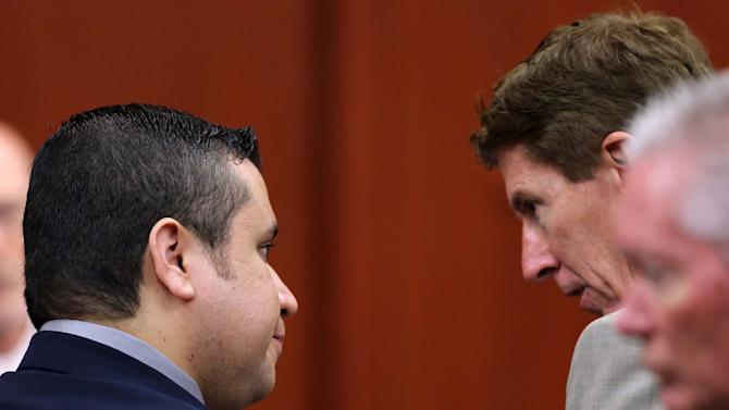 Defense attorney Mark O'Mara, right, talks with George Zimmerman in Seminole circuit court during jury selection for Zimmerman's trial in Sanford, Fla., Tuesday, June 18, 2013. Zimmerman has been charged with second-degree murder for the 2012 shooting death of Trayvon Martin.(AP Photo/Orlando Sentinel, Joe Burbank, Pool)
