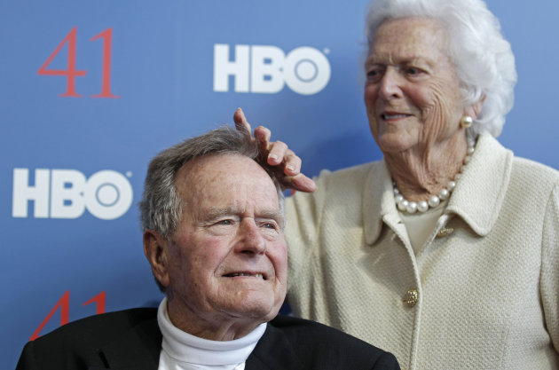 Former first lady Barbara Bush touches the hair of her husband President George H.W. Bush as they arrive for the premiere of HBO's new documentary on his life in Kennebunkport, Maine, Tuesday, June 12