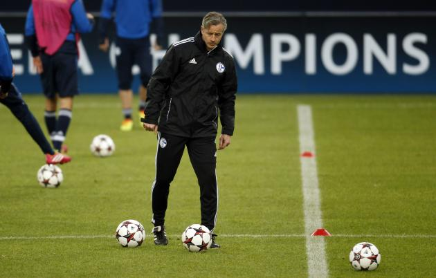 Schalke 04's coach Keller kicks a ball during a training session in Gelsenkirchen