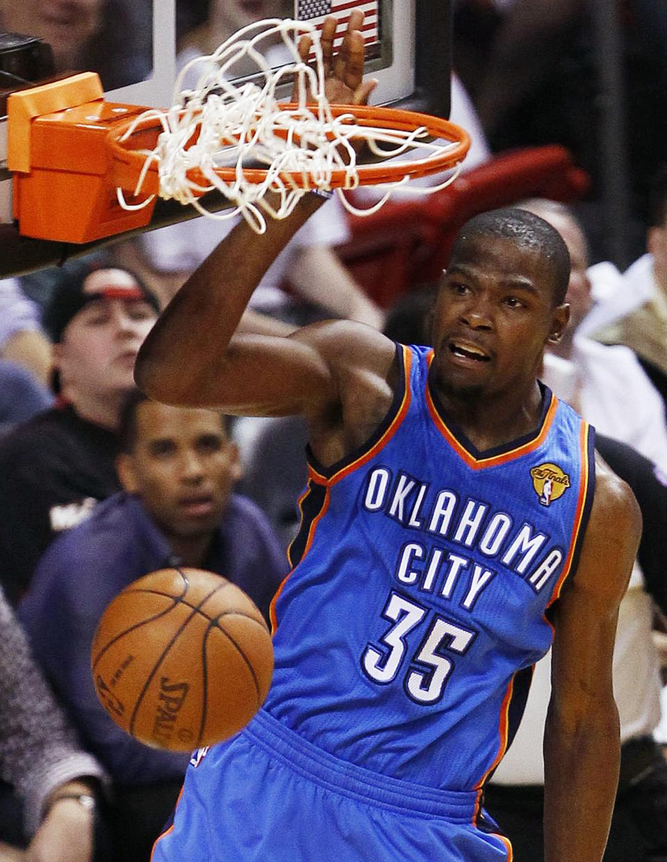 Oklahoma City Thunder small forward Kevin Durant (35) dunks against the Miami Heat during the first half at Game 3 of the NBA Finals basketball series, Sunday, June 17, 2012, in Miami. (AP Photo/Wilfredo Lee)