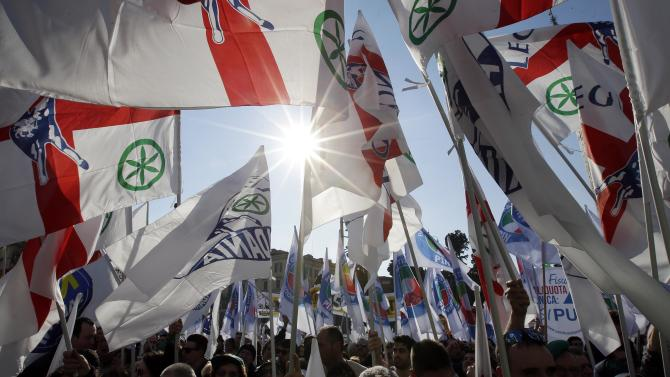 Supporters wave flags during a rally held by Northern League party leader Matteo Salvini in Rome