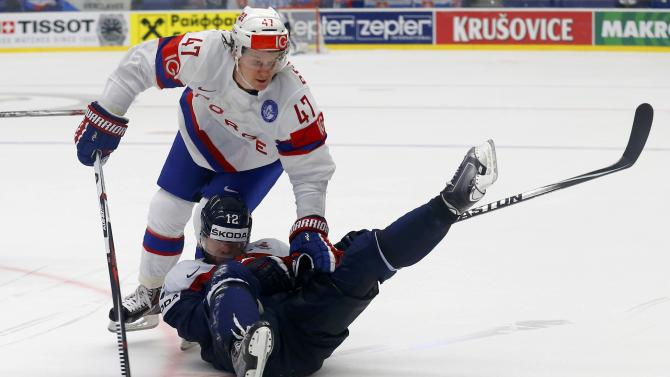 Norway's Bonsaksen fights for the puck with Slovakia's Gaborik during their ice hockey World Championship game in Ostrava
