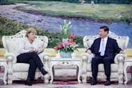 German Chancellor Angela Merkel (left) and Chinese Vice President Xi Jinping chat during their meeting at the Great Hall of the People in Beijing on August 30. The failure to provide any explanation for why Xi has not been seen in public since September 1 has given rise to rumours online and in overseas Chinese-language media, including that he had been involved in a car accident