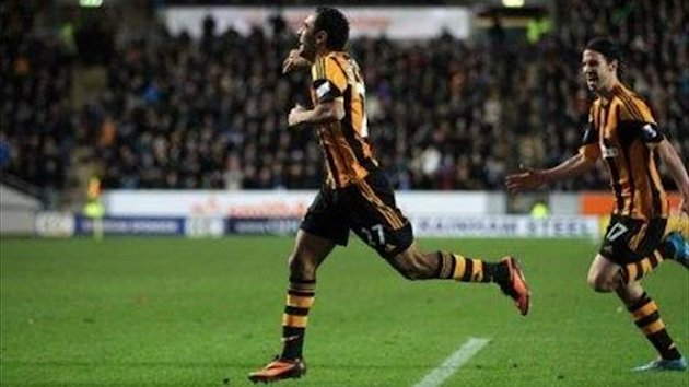 Hull City's Ahmed Elmohamady (left) celebrates scoring the opening goal of the game against Fulham (PA Photos)