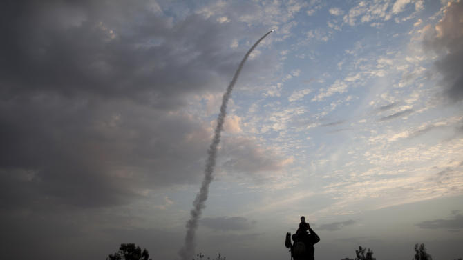 An Iron Dome missile is launched in Tel Aviv, to intercept a rocket fired from Gaza, Saturday, Nov. 17, 2012. Israel bombarded the Hamas-ruled Gaza Strip with nearly 200 airstrikes early Saturday, the military said, widening a blistering assault on Gaza rocket operations to include the prime minister's headquarters, a police compound and a vast network of smuggling tunnels. (AP Photo/Oded Balilty)
