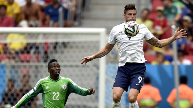 France's Olivier Giroud, right, gets above Nigeria's Kenneth Omeruo during the World Cup round of 16 soccer match between France and Nigeria at the Estadio Nacional in Brasilia, Brazil, Monday, June 30, 2014. (AP Photo/Martin Meissner)