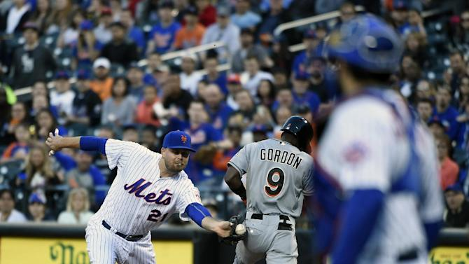 Miami Marlins' Dee Gordon (9) beats the tag of New York Mets first baseman Lucas Duda (21) to get safely to first base in the first inning of a baseball game at Citi Field on Saturday, April 18, 2015, in New York. (AP Photo/Kathy Kmonicek)