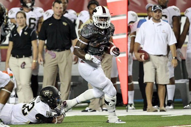 Aug 28, 2014; Monroe, LA, USA; Louisiana Monroe Warhawks running back Centarius Donald (5) rushes as Wake Forest Demon Deacons safety Ryan Janvion (22...