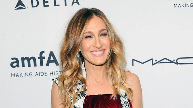 FILE - This Feb. 6, 2013 file photo shows actress Sarah Jessica Parker at amfAR's New York gala at Cipriani Wall Street in New York. Parker is donating a pair of Dolce Vita Pumps for a celebrity shoe auction benefitting LaGuardia High School of Music, Art and the Performing Arts. The special edition auction will take place starting Wednesday April 24, on http://www.gottahaverockandroll.com. (Photo by Evan Agostini/Invision/AP, file)