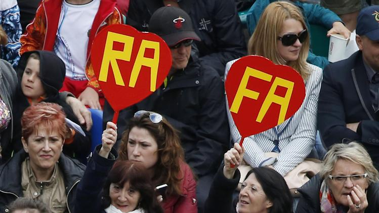 Supporters of Rafael Nadal of Spain, hold cuts outs of a heart with his nickname, as he played against Teymuraz Gabashvili of Russia during their match of the Monte Carlo Tennis Masters tournament in Monaco, Wednesday, April 16, 2014. Nadal won 6-4 6-1