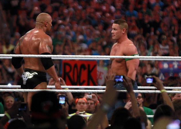 COMMERCIAL IMAGE - In this photograph taken by AP Images for WWE, Dwyane 'The Rock' Johnson, left, and John Cena face off at WrestleMania XXVIII in Sun Life Stadium on Sunday, April 1, 2012 in