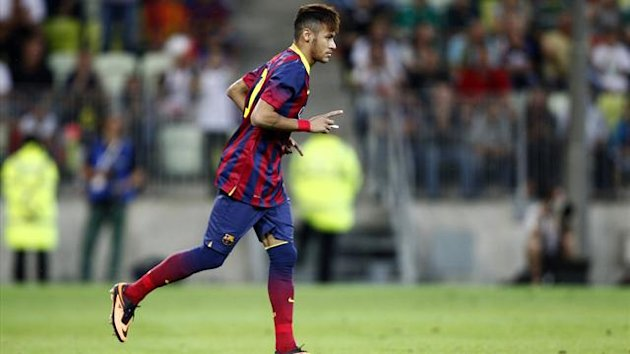 Barcelona's Neymar gestures as he runs during their friendly match against Lechia Gdansk (Reuters)