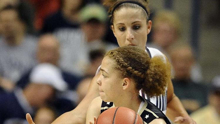 Vanderbilt's Jasmine Jenkins, right, looks to pass while guarded by Connecticut's Caroline Doty, left, in the first half of a second-round game in the women's NCAA college basketball tournament in Storrs, Conn., Monday, March 25, 2013. (AP Photo/Jessica Hill)