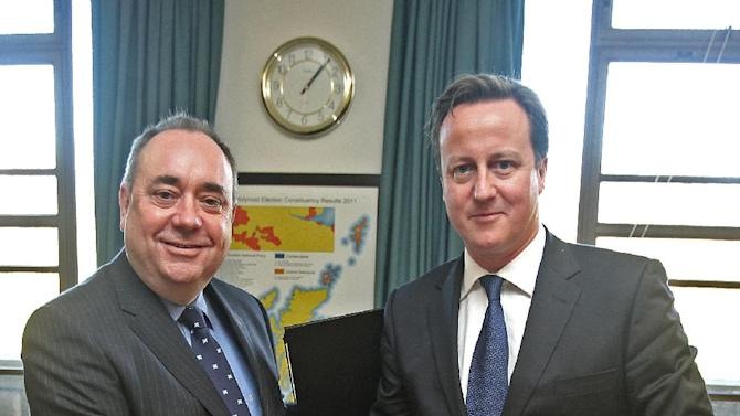 Britain's Prime Minister David Cameron, right, and Scotland's First Minister Alex Salmond, shake hands after signing a referendum agreement during a meeting at St Andrews House in Edinburgh, Monday, Oct. 15, 2012. Cameron met with the leader of Scotland's separatist administration Monday to sign a deal on a referendum that could break up the United Kingdom. Officials from London and Edinburgh have been meeting for weeks to hammer out details of a vote on Scottish independence. Sticking points included the date and the wording of the question. (AP Photo/Gordon Terris, Pool)