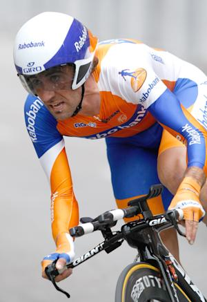 FILE - In this June 3, 2012, file photo, Rabobank rider Carlos Barredo of Spain, speeds past during the prologue of the 64th Dauphine cycling race, in Grenoble, France. Cycling's governing body is investigating Barredo for doping. The UCI says it has opened a disciplinary case against Barredo following analysis of his blood profile in the biological passport doping program. (AP Photo/Claude Paris, File)