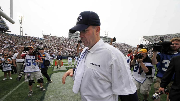 Penn State head coach Bill O'Brien walks off the field after an NCAA college football game against Ohio at Beaver Stadium in State College, Pa., Saturday, Sept. 1, 2012. Ohio won 24-14. (AP Photo/Gene J. Puskar)