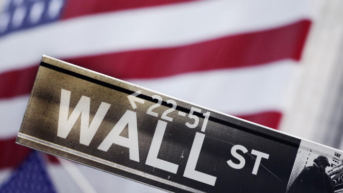 FILE - This Aug. 9, 2011 file photo shows a Wall Street street sign near the New York Stock Exchange, in New York. Global stock markets mostly rose Friday, Aug. 15, 2014 cheered by the prospect of more gains on Wall Street and a sense that Ukraine tensions are easing. (AP Photo/Mark Lennihan, File)
