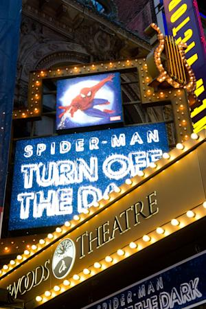 """FILE - In a Dec. 22, 2010 photo, the marquee for the Broadway musical """"Spider-Man Turn: Off the Dark"""" is illuminated outside the Foxwoods Theatre on West 42nd Street in New York. A stuntman who claims he sustained a concussion and two holes in his knees while performing in Broadway's """"Spider-Man: Turn Off the Dark"""" has asked producers to turn over any relevant information as he weighs pursuing a negligence lawsuit. The stuntman, Richard Kobak, claims in a series of papers filed earlier this year in New York State Supreme Court that he sustained the leg injuries in 2010 while filling in for another injured stuntman. (AP Photo/Charles Sykes, file)"""