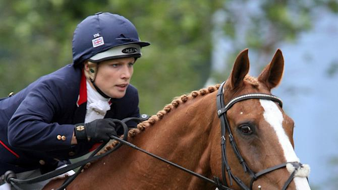 FILE - This Friday, July 6, 2007 file photo shows Britain's Zara Phillips, a granddaughter of Queen Elizabeth II, riding 'Toytown'  in the jumping test competition of the Event Competitions at the World Equestrian Festival CHIO Aachen 2007 in Aachen, western Germany. Phillips has been announced Monday June 11 2012 as being selected for the UK Eventing Olympic team.  The 2006 world champion will emulate her mother, the Princess Royal, who competed at the 1976 Montreal Games, while her father Captain Mark Phillips was a team gold medallist at Munich in 1972 and then won silver in Seoul 16 years later (AP Photo/Hermann J. Knippertz, File)