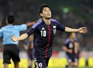 Japan&#39;s Shinji Kagawa celebrates after scoring a goal during the football friendly against Azerbaijan on May 23. Japan host Oman in their opening Group B match at the Saitama Stadium