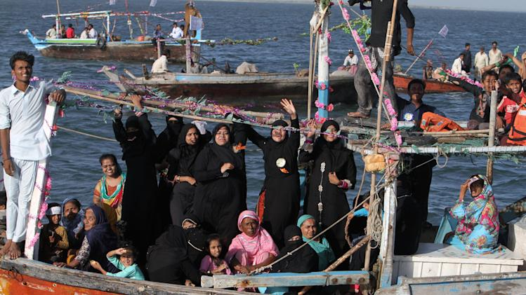 In this Friday, May 3, 2013 photo, supporters of a Pakistani election candidate participate in a waterborne rally to highlight the challenges faced by their embattled fishing community in the Arabian Sea off the coast of Karachi, Pakistan. Backers of independent political candidate Haji Usman Ghani took to the water Friday on a flotilla of fishing boats in the run up to the  May 11, 2013 vote which will mark the first time that a democratically elected civilian government has finished a full term and handed over power to another such government in Pakistan. (AP Photo/Fareed Khan)