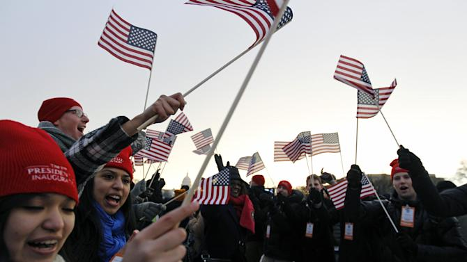 Spectators wave American flags on the National Mall in Washington, Monday, Jan. 21, 2013, before the start of President Barack Obama's ceremonial swearing-in ceremony during the 57th Presidential Inauguration. ( AP Photo/Jose Luis Magana)