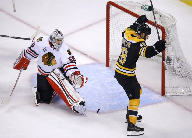 Bruins' Horton celebrates a goal on Blackhawks goalie Crawford by teammate Boychuk during the third period in Game 4 of their NHL Stanley Cup Finals hockey series in Boston