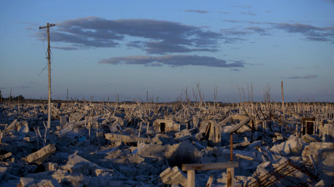 In this May 6, 2013 photo, buildings lay in ruins in Epecuen,  a village that was once submerged by water in Argentina. Epecuen was once a bustling little lakeside resort, where 1,500 people served 20,000 tourists a season. During Argentina's golden age, the same trains that carried grain to the outside world brought visitors from the capital to relax in Epecuen's saltwater baths and spas. (AP Photo/Natacha Pisarenko)