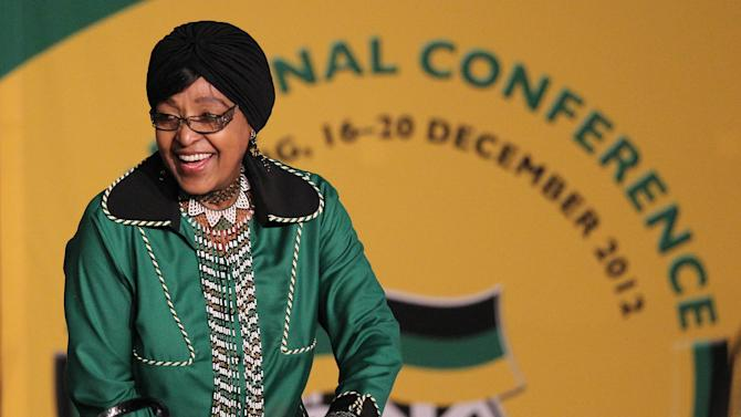 Ruling party African National Congress (ANC) member Winnie Madikizela-Mandela attends the nominations session for the new leadership of the ANC's elective conference at the University of the Free State in Bloemfontein, South Africa, Monday, Dec. 17, 2012. (AP Photo/Themba Hadebe)