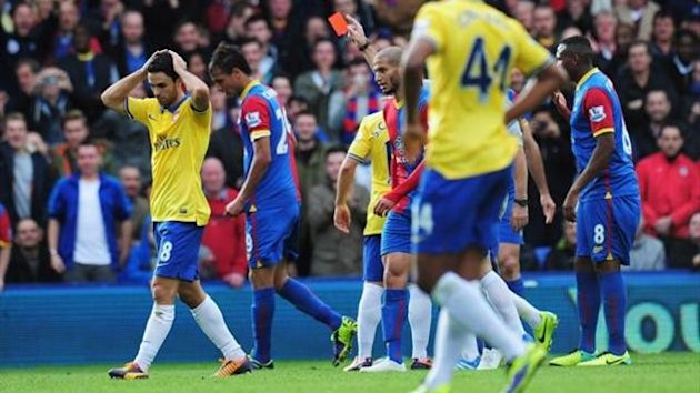 Mikel Arteta of Arsenal is shown the red card by referee Chris Foy during the Barclays Premier League match between Crystal Palace and Arsenal at Selhurst Park on October 26, 2013
