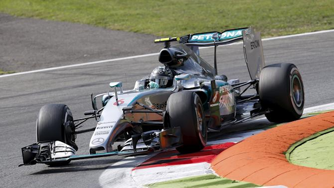 Mercedes Formula One driver Rosberg of Germany takes a curve during the first free practice session for the Italian F1 Grand Prix in Monza